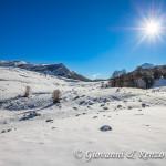 Piano Toscano e sullo sfondo il Varco del Pollino divide Serra delle Ciavole da Serra Dolcedorme
